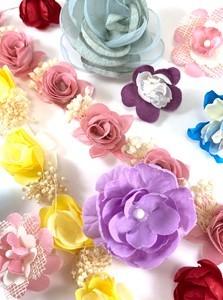 Flores de tela para vestidos y tocados